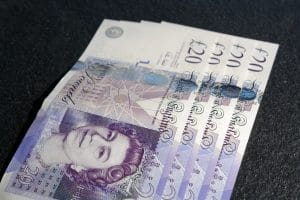 Debt Management Plan - Close up of £20 sterling note